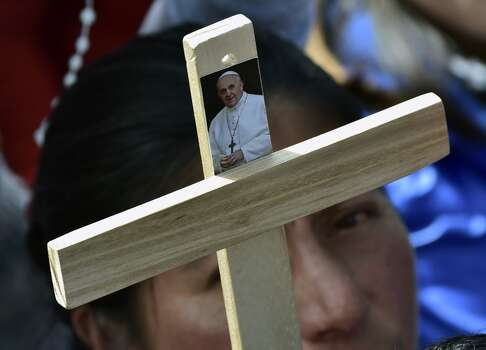 Hundreds of faithful gather before the start of an open-air mass by Pope Francis at the Bicentennial Park in Quito, Ecuador, on July 7, 2015. The visit of the Argentine-born pontiff comes amid widespread unrest over the socialist policies of President Rafael Correa --who is expected to attend the mass. Photo: RODRIGO BUENDIA, AFP/Getty Images