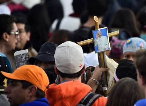 Faithful gather before an open-air mass officiated by Pope Francis at the Bicentennial Park in Quito, Ecuador, on July 7, 2015 early morning. Pope Francis celebrates his second open air mass in as many days in Ecuador the capital city roiled for the past month by anti-government protests. Hundreds of thousands of faithful were expected to turn out to see the Argentine-born pontiff, who offered a message of harmony and familial unity at an open air mass Monday in the coastal city of Guayaquil. Photo: RODRIGO BUENDIA, AFP/Getty Images