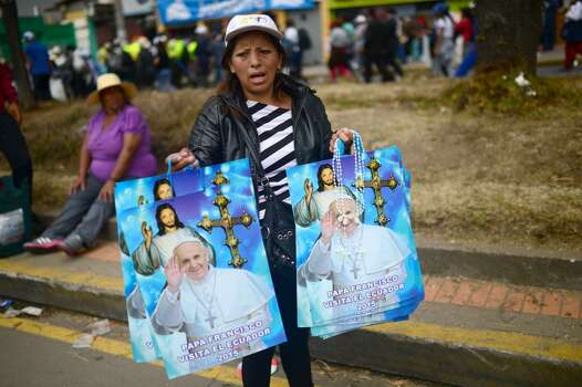 A peddler sells memorabilia  of Pope Francis in Quito, on July 7, 2015. Pope Francis celebrated his second open air mass in as many days in Ecuador on Tuesday, this time in Quito, the capital city roiled for the past month by anti-government protests. Photo: MARTIN BERNETTI, AFP/Getty Images