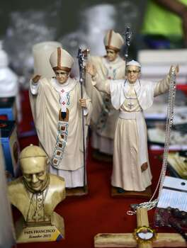 View of memorabilia of Pope Francis for sale in Quito, on July 7, 2015. Pope Francis celebrated his second open air mass in as many days in Ecuador, this time in Quito, the capital city roiled for the past month by anti-government protests. Photo: MARTIN BERNETTI, AFP/Getty Images
