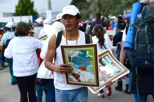 A peddler sells images of Pope Francis in Quito, on July 7, 2015. Pope Francis celebrates his second open air mass in as many days in Ecuador on Tuesday, this time in Quito, the capital city roiled for the past month by anti-government protests. Photo: MARTIN BERNETTI, AFP/Getty Images