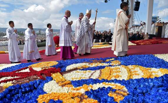 Pope Francis is seen before celebrating an open-air mass at the Bicentennial Park in Quito, Ecuador, on July 7, 2015. The visit of the Argentine-born pontiff comes amid widespread unrest over the socialist policies of President Rafael Correa --who is expected to attend the mass. Photo: VINCENZO PINTO, AFP/Getty Images