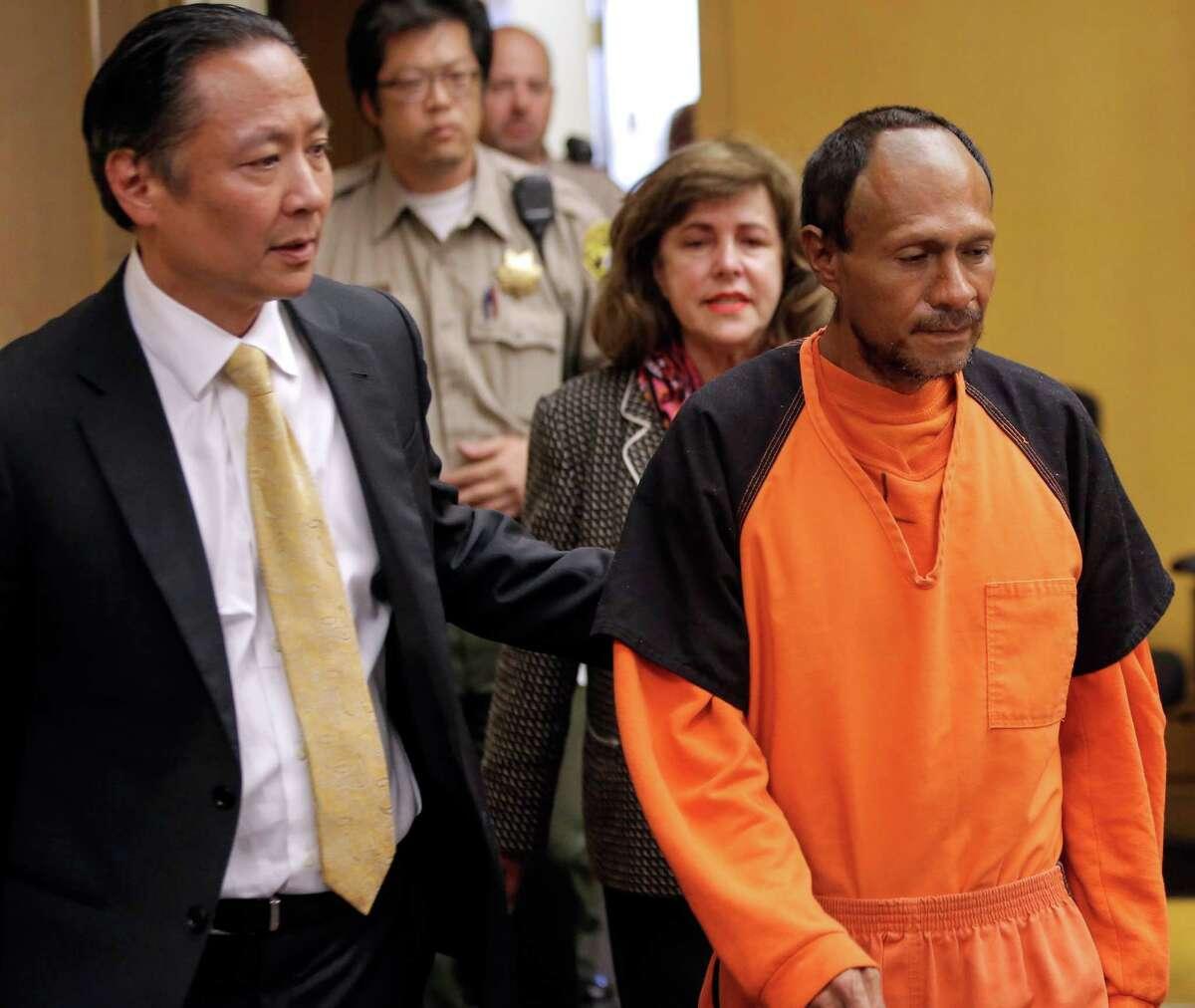 Public Defender Jeff Adachi leads Juan Francis co Lopez- San chez into a San Francisco court, where he pleaded not guilty. Story, A11.
