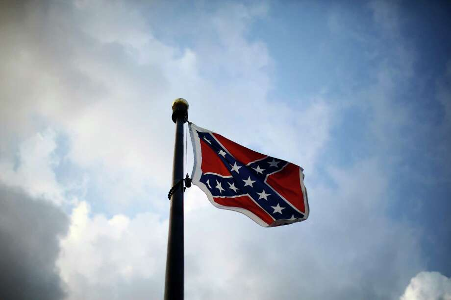 The Confederate battle flag flies outside the South Carolina State House in Columbia, S.C. It has since been taken down.Keep clicking to see the opinions of Americans on the Confederate flag. Photo: TRAVIS DOVE, STR / NYTNS