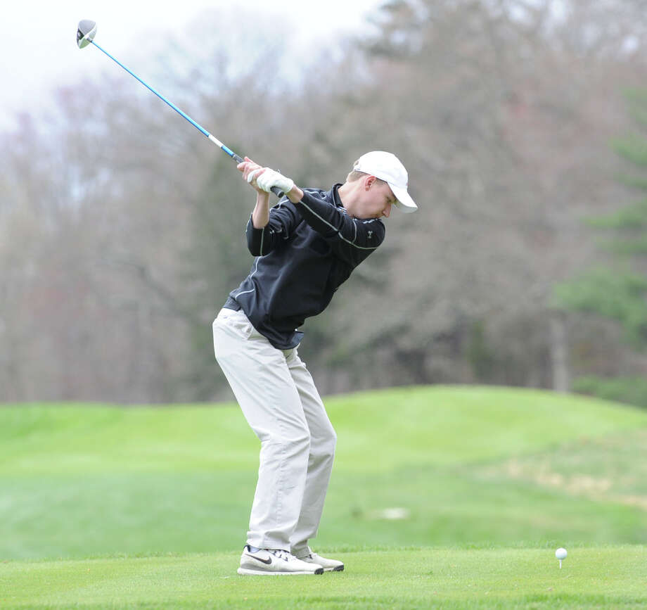 New Canaan High School's Chris Tohir tees off at the Round Hill Club in Greenwich, Conn. Photo: Bob Luckey / Greenwich Time