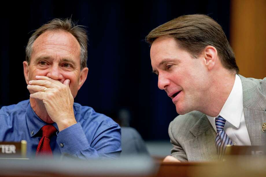 Rep. Ed Perlmutter, D-Colo., left, and Rep. Jim Himes, D-Conn., right, speak together as Treasury Secretary Jacob Lew testifies on Capitol Hill June 17, before a House Financial Services committee hearing on the annual report of the Financial Stability Oversight Council. (AP Photo/Andrew Harnik) Photo: Andrew Harnik / Associated Press / AP