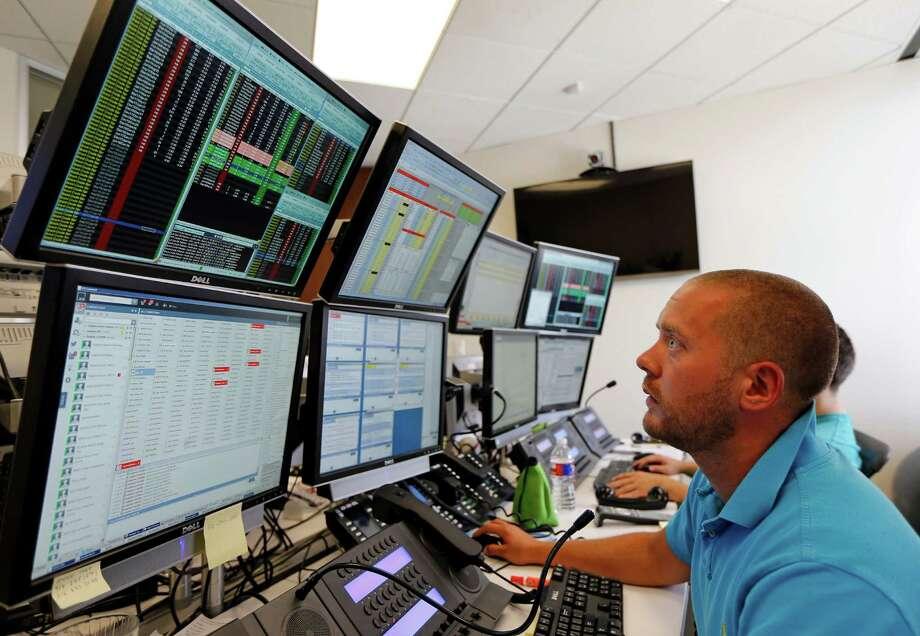 Jamie Spicer brokering oil commodities on the OTC Global Holdings Aalpha Energy Desk Tuesday, July 7, 2015, in Houston.  ( James Nielsen / Houston Chronicle ) Photo: James Nielsen, Staff / © 2015  Houston Chronicle