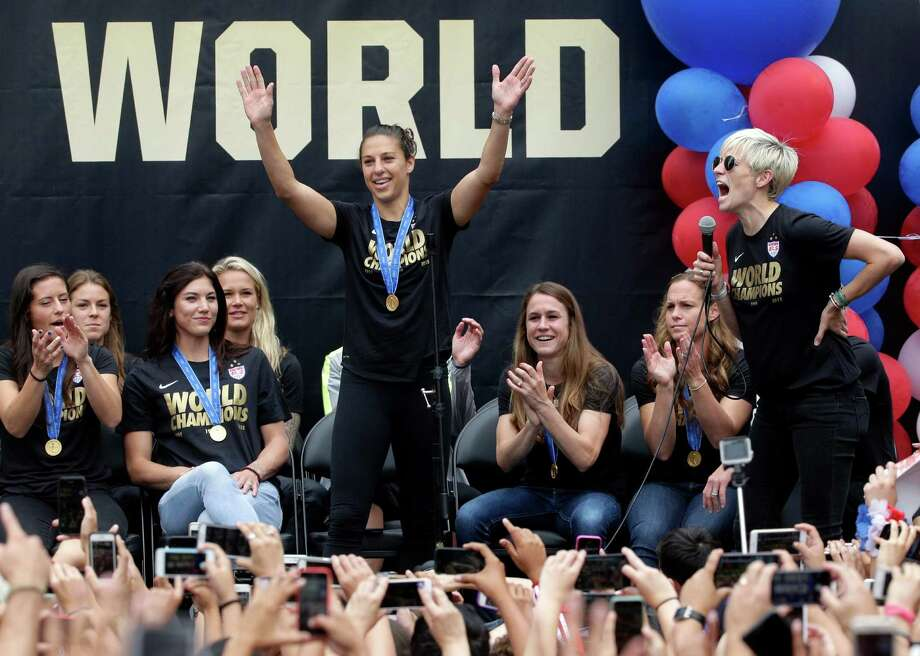 U.S. women's soccer team midfielder Megan Rapinoe, right, introduces teammate Carli Lloyd during a public rally held to celebrate the team's World Cup championship, Tuesday, July 7, 2015, in Los Angeles. This was the first U.S. stop for the team since beating Japan in the Women's World Cup final Sunday in Canada. (AP Photo/Jae C. Hong) Photo: Jae C. Hong, STF / AP