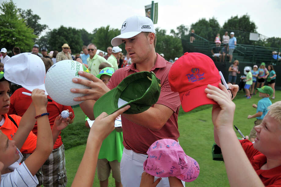 Jordan Spieth was in demand Tuesday as he arrived at the practice range for the John Deere Classic. Photo: Paul Colletti, MBO / The Dispatch