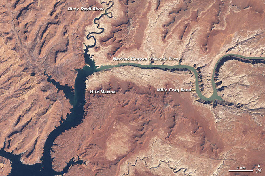"""Water level in Lake Powell (1999)Combined with human  demands, a multi-year drought in the Upper Colorado River Basin caused a  dramatic drop in the Colorado River's Lake Powell in the early part of  the 2000s. The lake began to recover in the latter part of the decade,  but as of 2015, it was still well below capacity.Keep clicking to see more """"Before and After"""" photos of the Earth.Source: Earth Observatory Photo: NASA"""