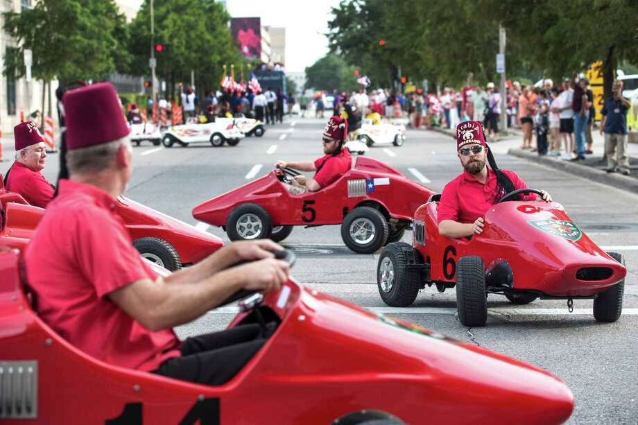 Shriners ride their mini cars as they parade through downtown on Tuesday, July 7, 2015, in Houston. Thousands of Shriners, bands, clowns mini-cars, motorcycles, horse patrols and marching units from around the world paraded to mark the 141st annual Imperial Session of the fraternity. Photo: Brett Coomer, Houston Chronicle / © 2015 Houston Chronicle