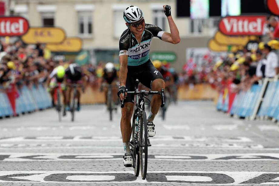 CAMBRAI, FRANCE - JULY 07:  Tony Martin of Germany riding for Etixx-QuickStep celebrates as he wins stage four of the 2015 Tour de France from Seraing, Belgium to Cambrai, France on July 7, 2015 in Cambrai, France.  (Photo by Doug Pensinger/Getty Images) ORG XMIT: 560071801 Photo: Doug Pensinger / 2015 Getty Images