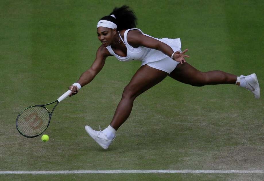 Serena Williams of the United States returns a ball to Victoria Azarenka of Belarus during their singles match at the All England Lawn Tennis Championships in Wimbledon, London, Tuesday July 7, 2015. (AP Photo/Tim Ireland) ORG XMIT: WIM263 Photo: Tim Ireland / AP