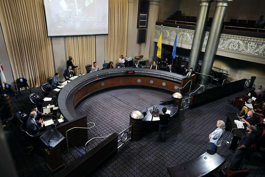 Council members sit at the dais and listen to public comments during an Oakland City Council held at City Hall in Oakland, CA Wednesday, July 7, 2015. Photo: Michael Short, Special To The Chronicle