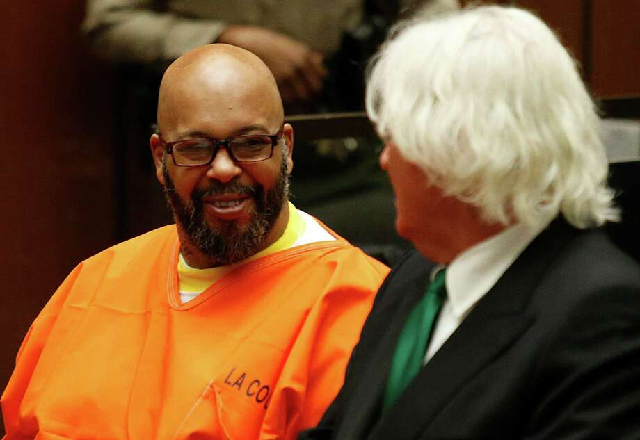 """Marion Hugh """"Suge"""" Knight sits with his attorney Thomas Mesereau in Los Angeles Superior Court during a hearing on a robbery case involving Knight and comedian Micah """"Katt"""" Williams, filed after acelebrity photographer accused the men of stealing her camera last year, Tuesday, July 7, 2015, in Los Angeles. A judge set a Sept. 17, 2015 preliminary hearing date for that case. (Patrick T. Fallon/Pool Photo via AP) Photo: Patrick T. Fallon, POOL / Pool Reuters"""