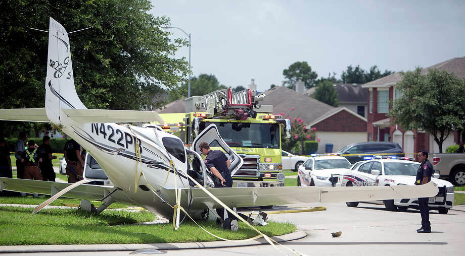 Authorities investigate after a plane landed in a northwest Harris County neighborhood. Photo: Cody Duty, Staff / © 2015 Houston Chronicle