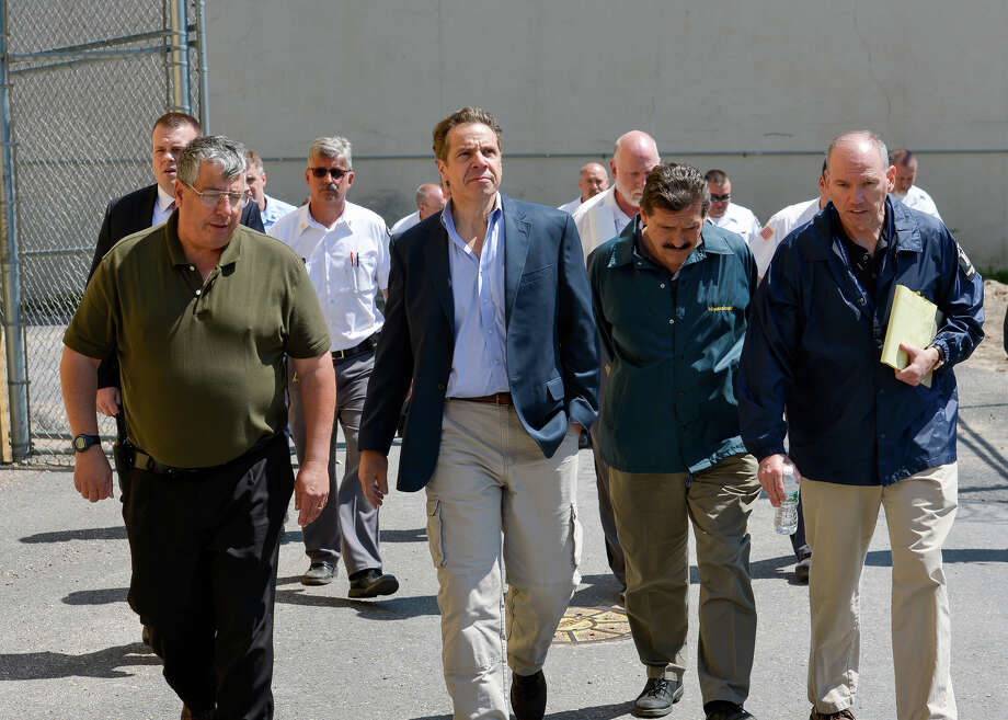 This June 6, 2015 photo provided by New York Gov. Andrew Cuomo's office shows Cuomo, second from left, walking with Steven Racette, left, superintendent of Clinton Correctional Facility, in Dannemora, N.Y. Racette and his deputy in charge of security are among 12 more staff who have been put on administrative leave during the investigation into David Sweat and Richard Matt's escape from the maxiumum-security facility, officials said Tuesday, June 30, 2015. (Darren McGee/Officer of the New York Governor via AP) ORG XMIT: NYMG102 Photo: Darren McGee / Governor Andrew Cuomo's Office