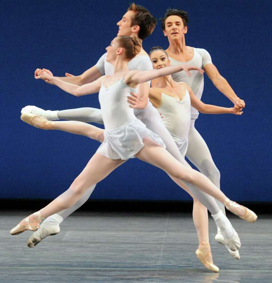 Dancers perform the George Balanchine choreographed Square Dance on opening night of the New York City Ballet at SPAC on Tuesday July 7, 2015 in Saratoga Springs, N.Y.  (Michael P. Farrell/Times Union) Photo: Michael P. Farrell / 00032498A
