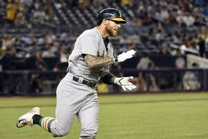 Brett Lawrie?s homer gives A?s first win in extras - Photo