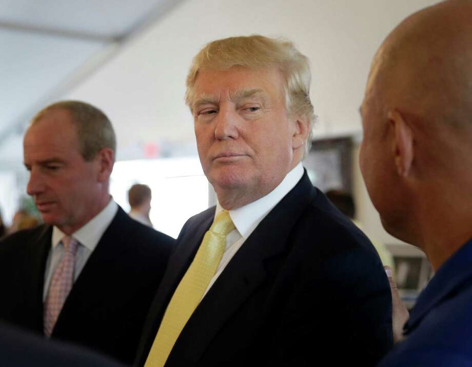 Republican presidential candidate Donald Trump arrives to a fund raising event at a golf course in the Bronx borough of New York, Monday, July 6, 2015. (AP Photo/Seth Wenig) Photo: Seth Wenig, STF / AP
