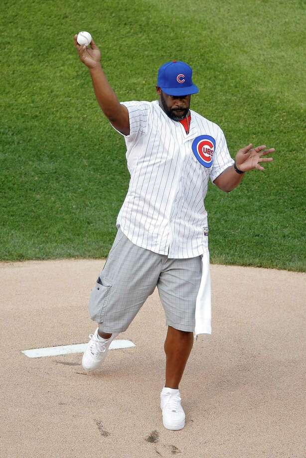 CHICAGO, IL - JULY 04: Former NFL quarterback Donovan McNabb throws out the first pitch before the game between the Chicago Cubs and the Miami Marlins at Wrigley Field on July 4, 2015 in Chicago, Illinois.  (Photo by Jon Durr/Getty Images) Photo: Jon Durr, Stringer / 2015 Getty Images