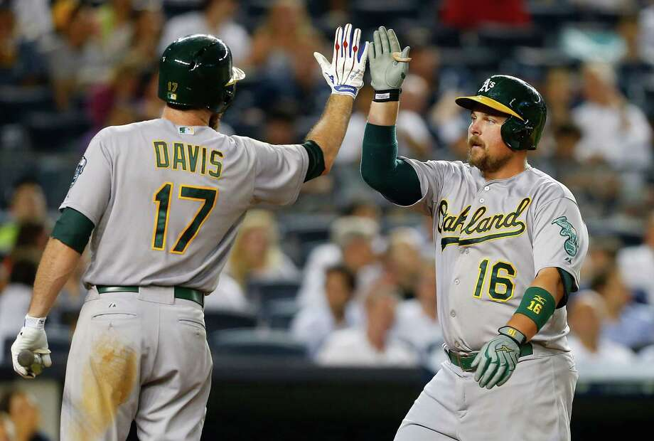 NEW YORK, NY - JULY 07:  Billy Butler #16 of the Oakland Athletics celebrates his sixth inning home run against the New York Yankees with teammate Ike Davis #17 at Yankee Stadium on July 7, 2015 in the Bronx borough of New York City.  (Photo by Jim McIsaac/Getty Images) ORG XMIT: 538586265 Photo: Jim McIsaac / 2015 Getty Images
