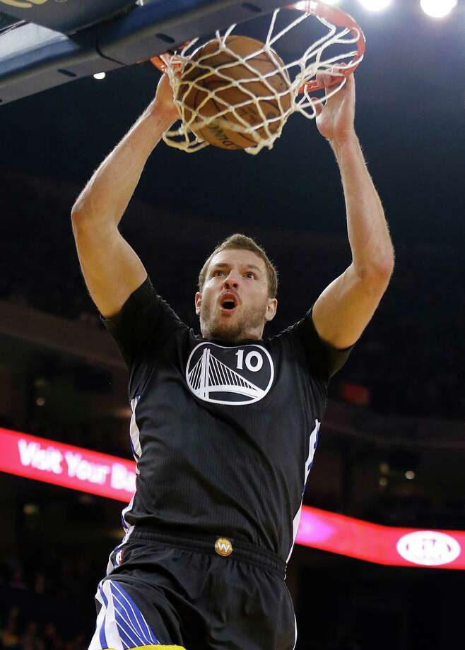 Golden State Warriors forward David Lee dunks against the Minnesota Timberwolves during the first quarter of an NBA basketball game in Oakland, Calif., Saturday, Dec. 27, 2014. (AP Photo/Jeff Chiu) Photo: Jeff Chiu, STF / AP