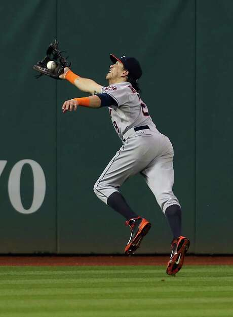 Astros center fielder Colby Rasmus takes a hit away from the Indians' Michael Bourn with a running catch during the fifth inning. Photo: Ron Schwane, FRE / FR78273 AP