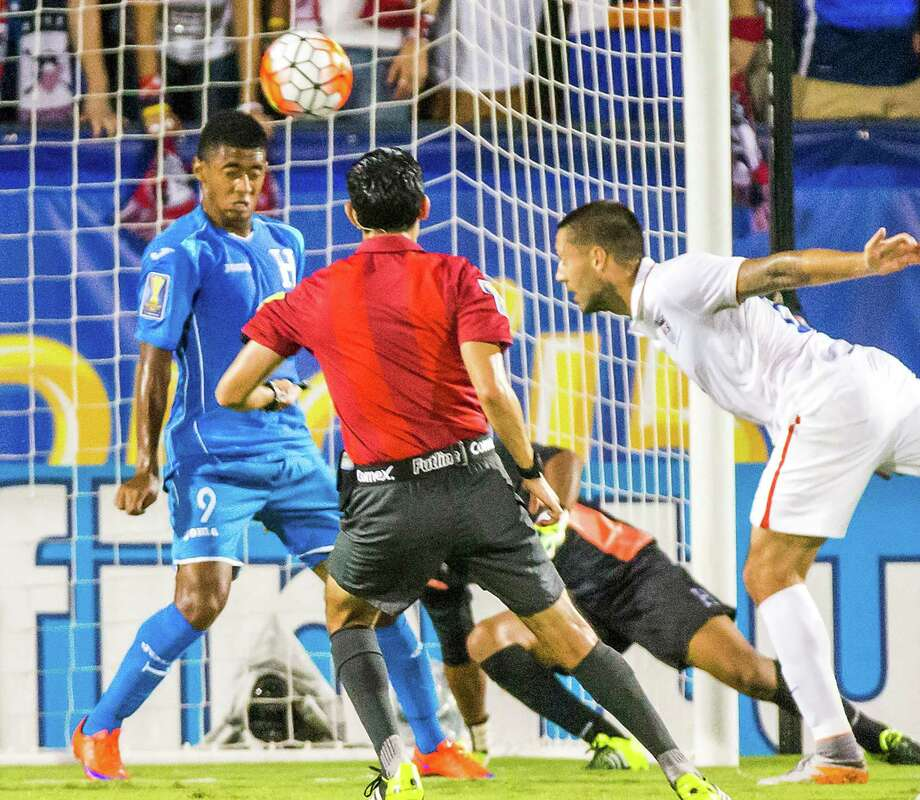 American Clint Dempsey, replaced as team captain last week, heads the ball past Honduras' Antony Lozano in the first half. Photo: Smiley N. Pool / McClatchy-Tribune News Service / Dallas Morning News