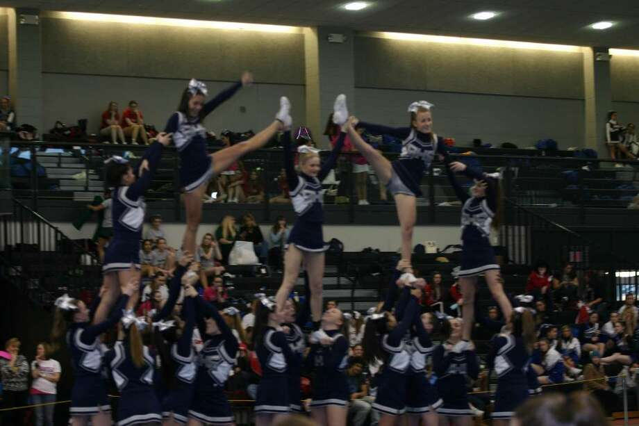 The Staples cheerleading squad turned in a clean routine at the Class LL championships on Saturday at the New Haven Athletic Center to finish in 10th place, its best finish in years. Photo: Contributed Photo
