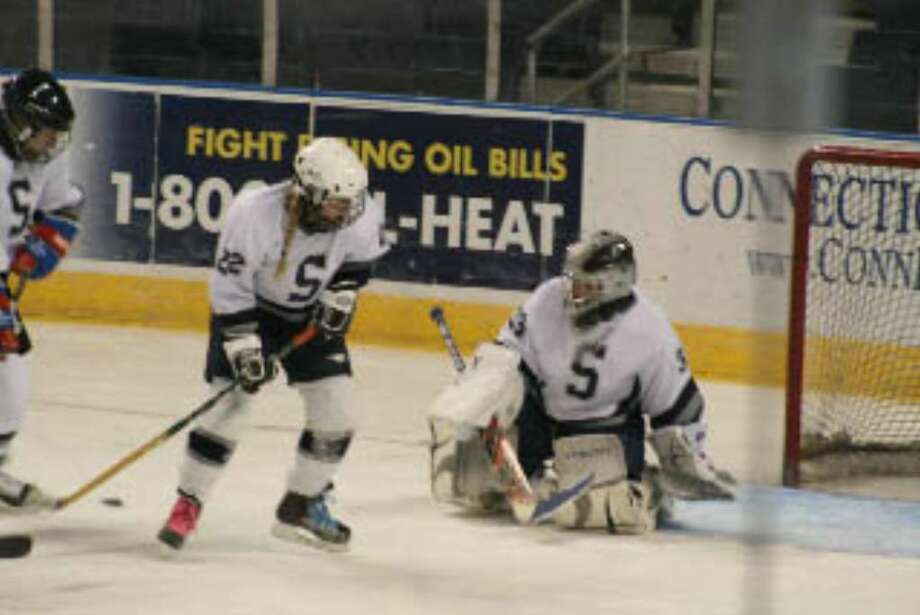 Staples junior Gwen Moyer makes the save. Moyer received the Most Improved Player award along with junior goalie Emma Kahn and she will be a captain next year along with classmate Kate Shanahan. Photo: Contributed Photo