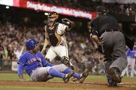 New York Mets' Curtis Granderson, left, is tagged out by San Francisco Giants catcher Andrew Susac in the sixth inning of a baseball game Tuesday, July 7, 2015, in San Francisco. Granderson was attempting to score on a fly ball hit by New York Mets third baseman Ruben Tejada.(AP Photo/Ben Margot)