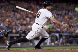 SAN FRANCISCO, CA - JULY 07:  Hunter Pence #8 of the San Francisco Giants hits and rbi single scoring Joe Panik #12 against the New York Mets in the bottom of the fifth inning at AT&T Park on July 7, 2015 in San Francisco, California.  (Photo by Thearon W. Henderson/Getty Images)
