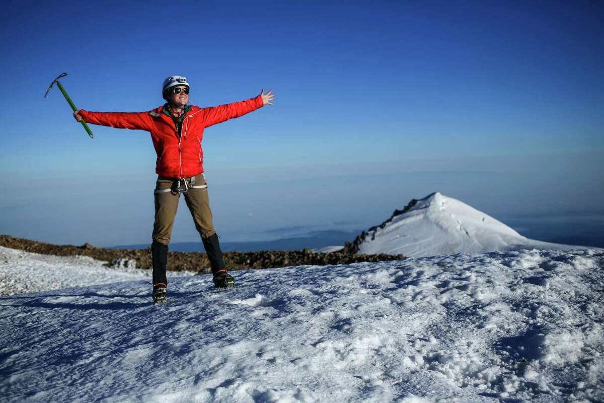 Climber Brigit Miller celebrates as she reaches Columbia Crest, the highest point of Mount Rainer at 14,411 feet. It was her first ascent of the mountain.