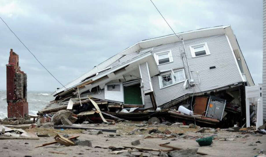 Town officials are reviewing a report that recommends flood-control options designed to prevent damage -- such as this destroyed home -- that occurred during Superstorm Sandy and other severe storms in the town's shoreline neighborhoods. Photo: File Photo / File Photo / Fairfield Citizen