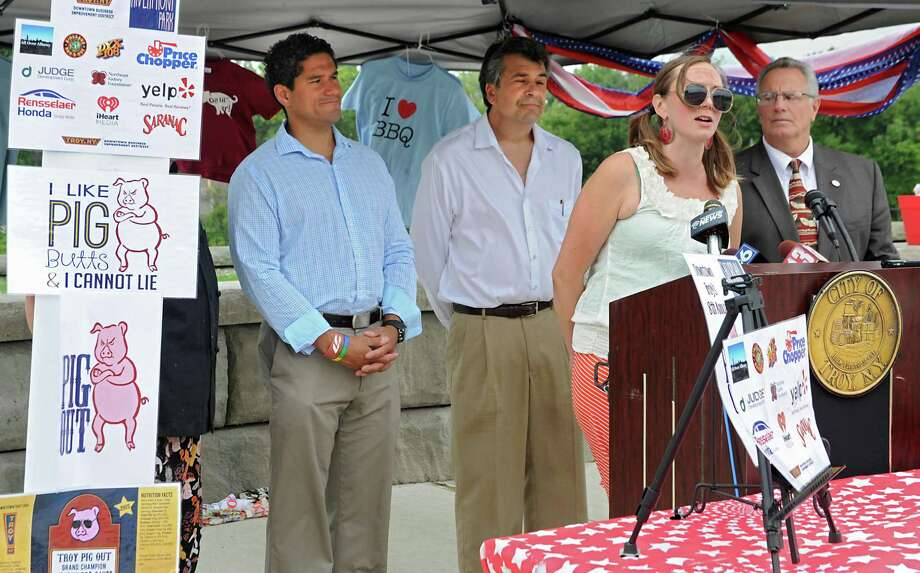 Erin Piihlaja, executive director Troy BID, speaks during a press conference discussing Troy's 8th Annual Pig Out on Tuesday, July 7, 2015, in Troy, N.Y. Behind her, from left, are City Council President Rodney Wiltshire, Vito Ciccarelli, special events coordinator and Troy Mayor Lou Rosamilia. (Lori Van Buren / Times Union) Photo: Lori Van Buren / 00032507A