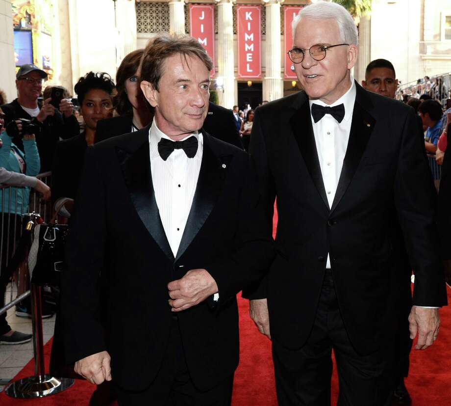 Martin Short (L) and honoree Steve Martin walk the red carpet at the 43rd AFI Life Achievement Award Gala honoring Martin at Dolby Theatre on June 4, 2015 in Hollywood. They will perform in San Antonio next year. Photo: Getty Images, Getty Images / 2015 Michael Kovac