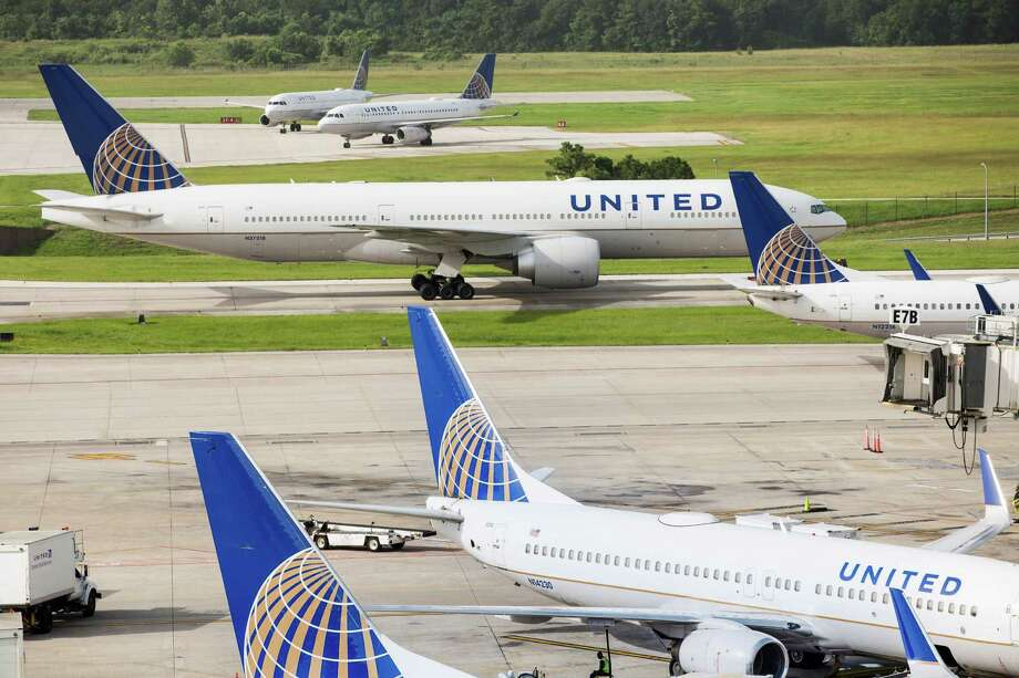 United Airlines planes sit parked on the tarmac at George Bush Intercontinental Airport on Wednesday, July 8, 2015, in Houston. All United flights in the United States were grounded Wednesday due to a computer problem. Photo: Brett Coomer, Houston Chronicle / © 2015 Houston Chronicle