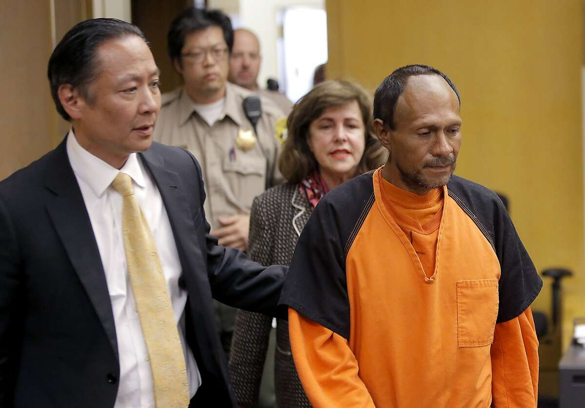 Francisco Sanchez, right, is lead into the courtroom by San Francisco Public Defender Jeff Adachi, left, and Assistant District Attorney Diana Garciaor, center, for his arraignment at the Hall of Justice on Tuesday, July 7, 2015 in San Francisco. Prosecutors have charged the Mexican immigrant with murder in the waterfront shooting death of 32-year-old Kathryn Steinle. (Michael Macor/San Francisco Chronicle via AP, Pool)