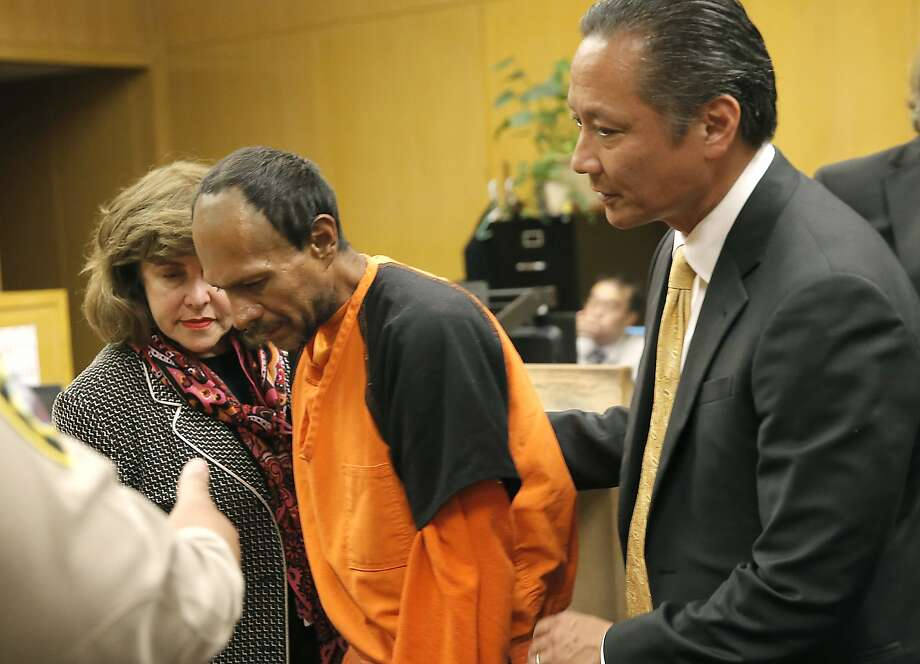 Francisco Sanchez, center, is lead out of the courtroom by San Francisco Public Defender Jeff Adachi, right, and a Spanish language interpreter (left), after his arraignment at the Hall of Justice on Tuesday. Photo: Michael Macor, Associated Press