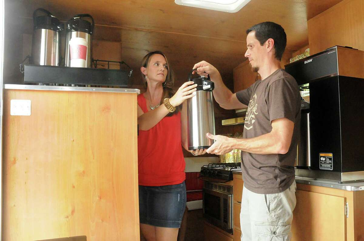 Dea and Ben Scogin, of Spring, prepare coffee at their Coffee for a Cause mobile coffee bar trailer. Photograph by David Hopper.