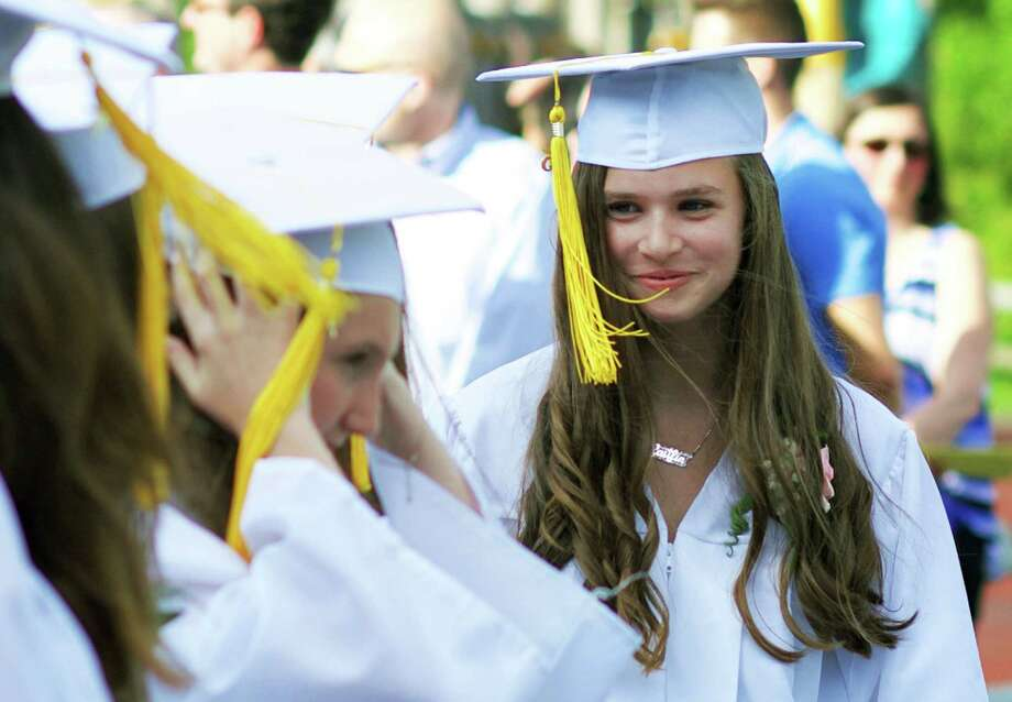 Caitlin Jellen beams as she takes her place amongst her classmates during Sherman School's eighth-grade graduation ceremony, June 19, 2015 Photo: Trish Haldin / Trish Haldin / The News-Times Freelance