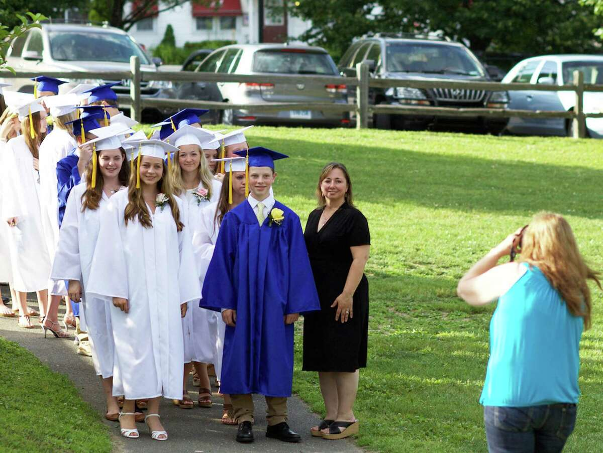 Devin Alward and Megan Godfrey lead the processional for Sherman School's eighth-grade graduation ceremony, June 19, 2015