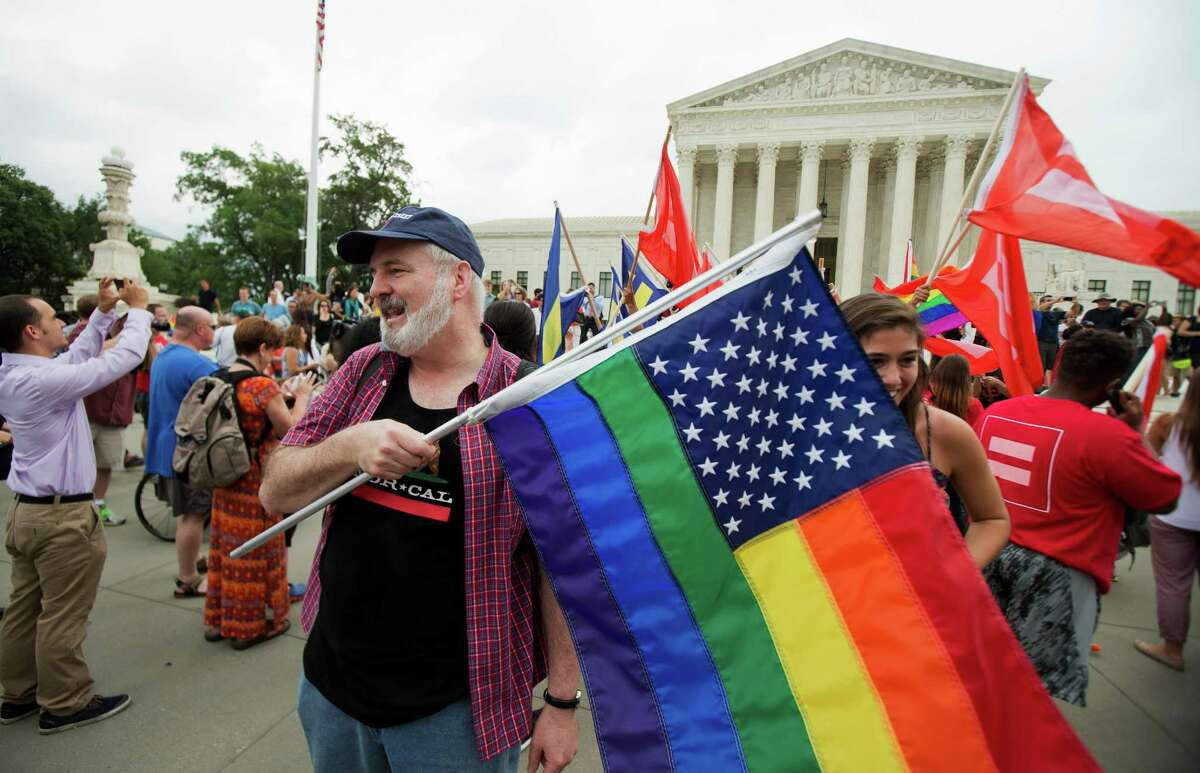 FILE - In this June 26, 2015 photo, supporters celebrate outside the Supreme Court in Washington, Friday, June 26, 2015 after the court declared that same-sex couples have a right to marry anywhere in the United States. This will be one of the topics Aug. 9 at