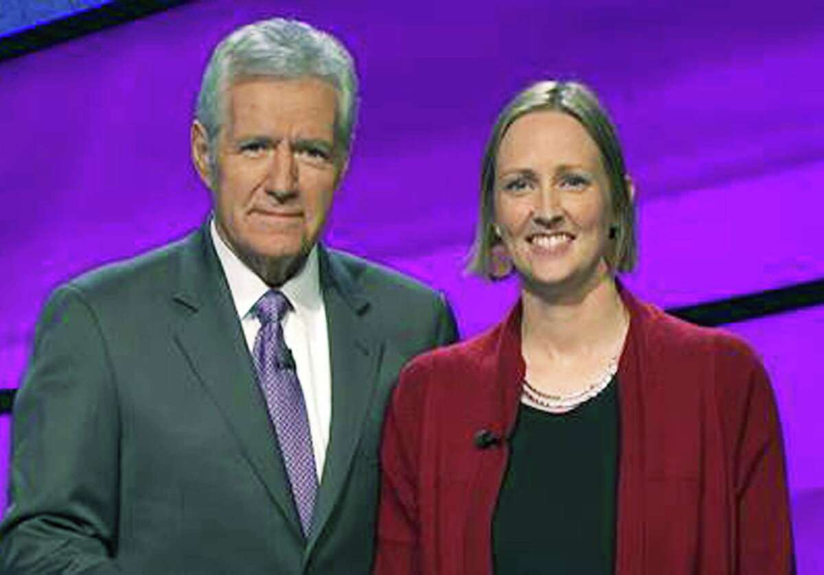 Jessica Lindoerfer, a New Milford High School graduate, poses with longtime Jeopardy TV game show host Alex Trebek during her successful appearance on the show. July 2015