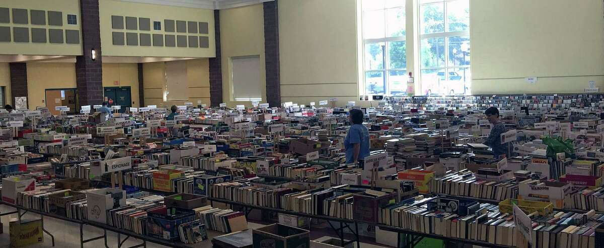 One of two gymnasiums devoted to books at Reed Intermediate School in Newtown, which will host the annual book sale to benefit Booth Library July 11 - 15.
