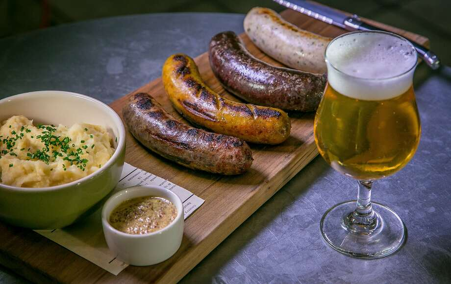 The sausage board with Belgian mash and a beer at Belga in San Francisco. Photo: John Storey, Special To The Chronicle