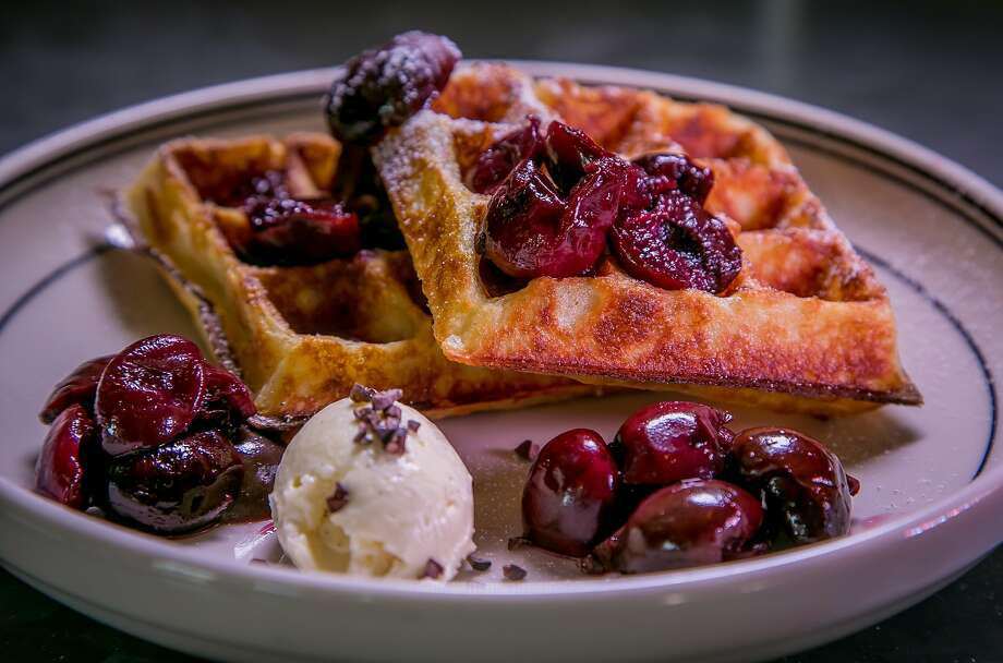 Belgian waffle with fruit ($8) is offered for dessert at Belga in S.F. Photo: John Storey, Special To The Chronicle