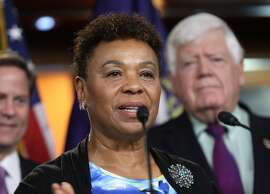 Rep. Barbara Lee, D-Calif., accompanied by fellow House Democrats, gestures during a news conference on Capitol Hill in Washington, Tuesday, June 16, 2016, to discuss opposition to the President Barack Obama's trade deal.  Despite Obama's direct appeal, House Democrats voted overwhelmingly on Friday to reject a jobs retraining program because it was legislatively linked to fast track, which they want to kill. Both parties were asking Tuesday whether they could persuade enough colleagues to switch their votes and reverse Friday's outcome, but few were optimistic.  (AP Photo/Lauren Victoria Burke)
