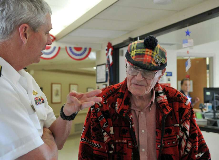 Veteran, John Beals, right, speaks with Navy Rear Admiral Thomas Moore about his experience serving as a Navy Fighter Pilot during a Albany Veterans Hospital Tour Wednesday, July 8, 2015, at The Albany Veterans Hospital in Albany, N.Y. (Phoebe Sheehan/Special to The Times Union) Photo: PS / 00032534A